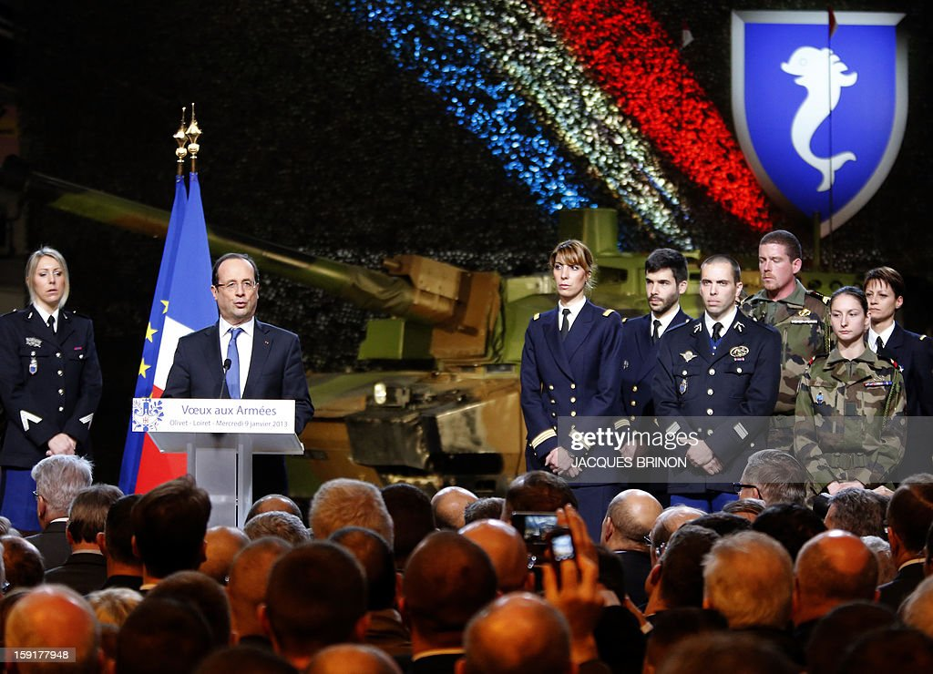 French President Francois Hollande addresses his wishes on January 9, 2013 in Olivet as part as his New Year's greetings to the French army forces. AFP PHOTO POOL JACQUES BRINON