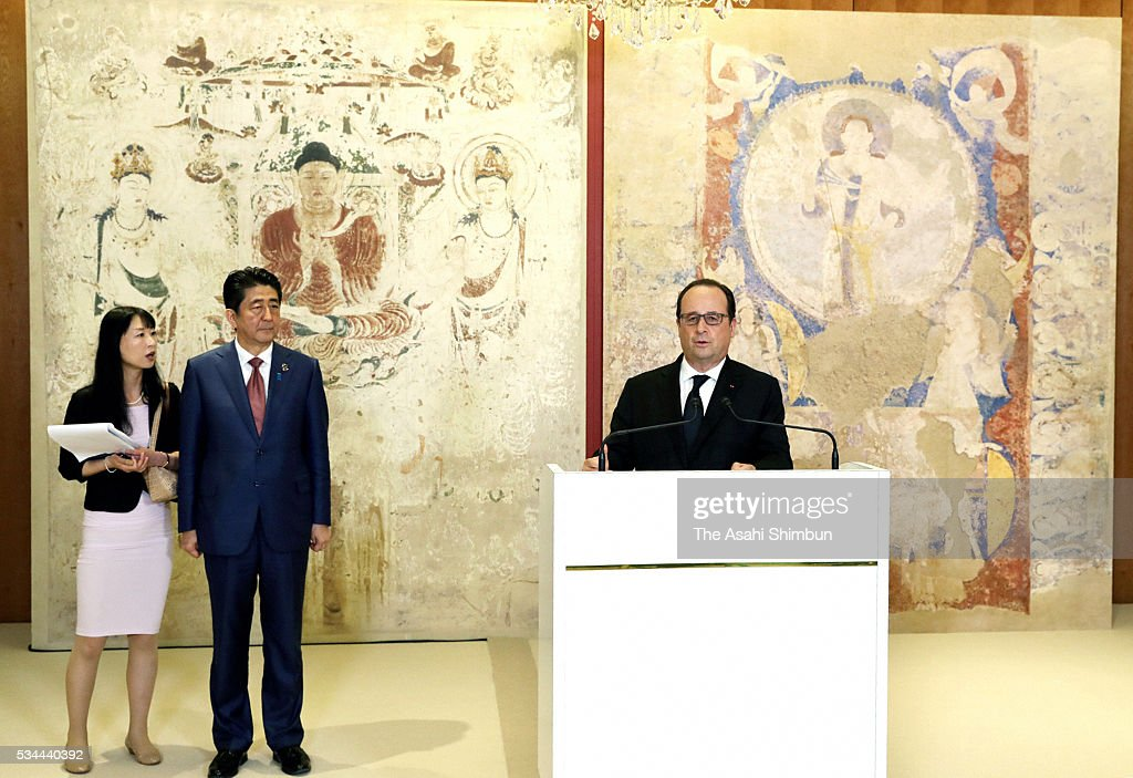 French President Francois Hollande (1st R) addresses in front of the reproduced mural of the Bamiyan, which was restored after destruction by the Taliban, at the Exhibitions about anti-terrorism and the conservation of cultural properties prior to the working dinner during the Group of Seven summit on May 26, 2016 in Shima, Mie, Japan. The 2-day Group of Seven summit takes place to discuss key global issues such as global economy and counter terrorism measures.