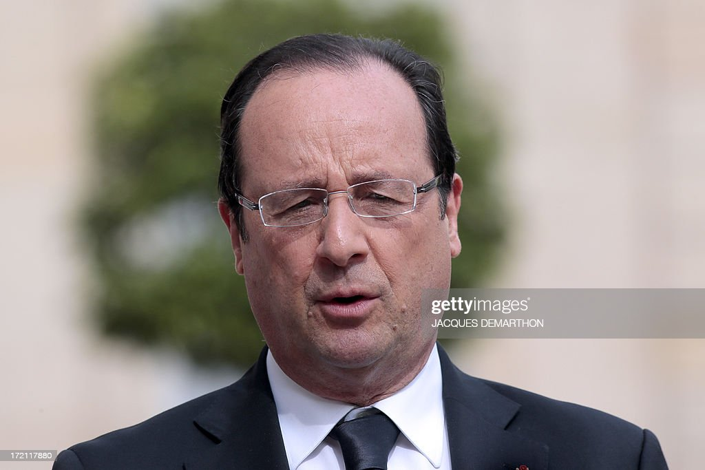 French President Francois Hollande addresses journalists after his meeting with Lithuanian president Dalia Grybauskaite on July 2, 2013 at the Elysee palace in Paris. Grybauskaite, whose country took over the EU presidency on July 1, met Hollande today amid European concerns over allegations of US spying on its offices. AFP PHOTO/ JACQUES DEMARTHON
