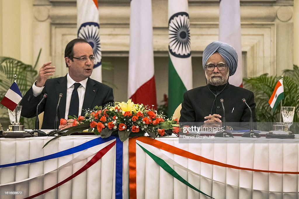 French President Francois Hollande addresses the media as Indian Prime Minister <a gi-track='captionPersonalityLinkClicked' href=/galleries/search?phrase=Manmohan+Singh&family=editorial&specificpeople=227120 ng-click='$event.stopPropagation()'>Manmohan Singh</a> looks on after the signing of agreements at Hyderabad House on February 14, 2013 in New Delhi, India. French President Francois Hollande arrived in India on Thursday for a two-day trip, his first to Asia since becoming President last year and hopes to build the way for important trade contracts.