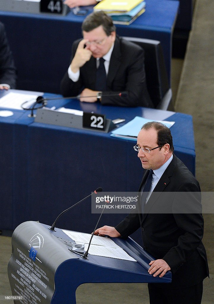 French President Francois Hollande (R) adresses the European Parliament in front of European Commission head Jose Manuel Barroso , on February 5, 2013 in Strasbourg, eastern France, two days before a summit on the EU budget.