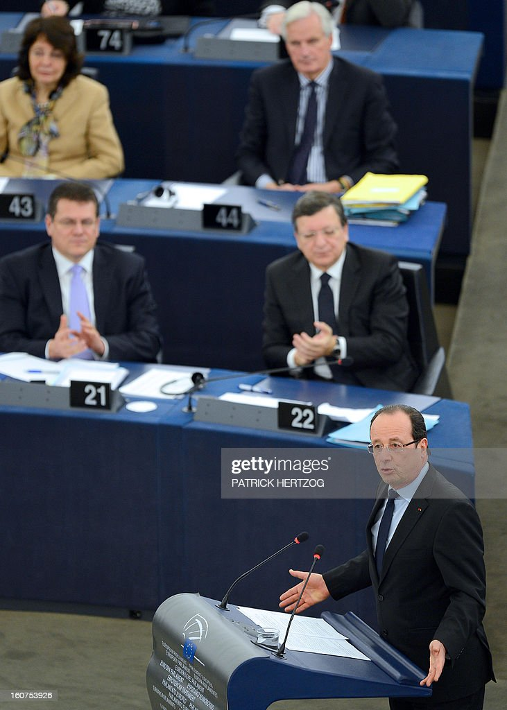 French President Francois Hollande (R) adresses the European Parliament in front of European Commission head Jose Manuel Barroso (back-C) , on February 5, 2013 in Strasbourg, eastern France, two days before a summit on the EU budget.