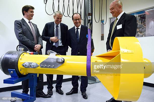 French President Francois Hollande along with Executive Vice President of Thales Defence Mission Systems Pierre Eric Pommellet Thales Australia CEO...