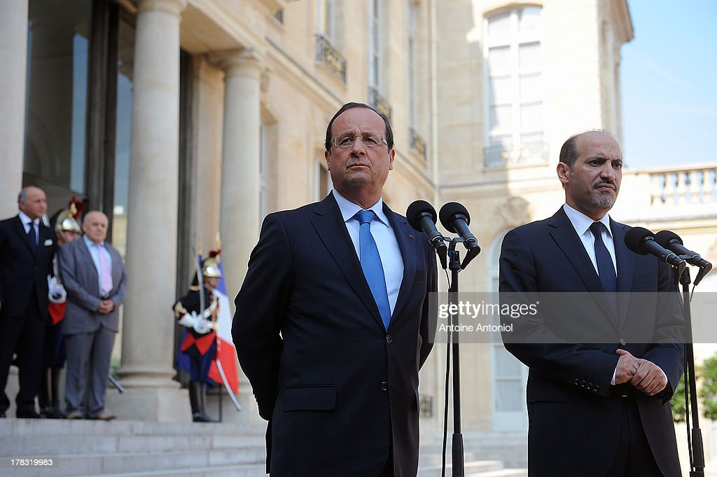 French President Francois Hollande (L) and Ahmad Al-Assi Al-Jarba, Leader Of Syrian National Coalition, speak during a joint press conference after a meeting at Elysee Palace on August 29, 2013 in Paris, France. Hollande has condemned Syria's alleged use of chemical weapons and has said he is 'ready to punish' those responsible.
