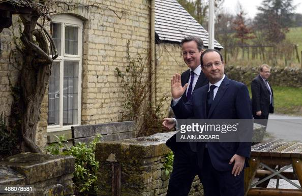 French president Francois Hollande and British Prime Minister David Cameron arrive for an informal lunch at The Swan Inn pub in Swinbrook near...