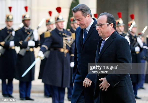 French President Francois Hollande and British Prime Minister David Cameron arrive to attend a meeting at the Elysee Presidential Palace on November...