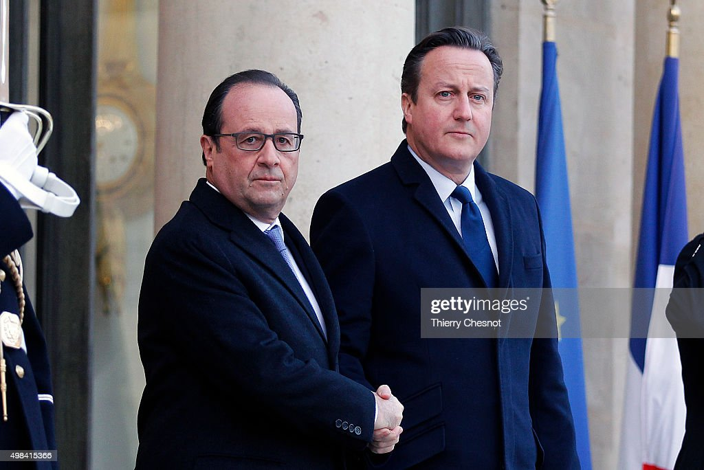 French President Francois Hollande and British Prime Minister <a gi-track='captionPersonalityLinkClicked' href=/galleries/search?phrase=David+Cameron+-+Politician&family=editorial&specificpeople=227076 ng-click='$event.stopPropagation()'>David Cameron</a> arrive to attend a meeting at the Elysee Presidential Palace on November 23, 2015 in Paris, France. The meeting comes over a week after the Paris terrorist attacks that claimed at least 129 lives in the French capital.