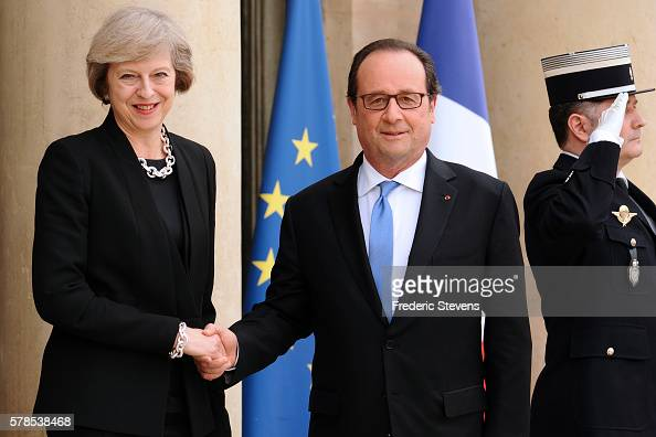 French President Francois Hollande and British Prime Minister Theresa May arrive for a meeting at Elysee Palace on July 21 2016 in Paris France...