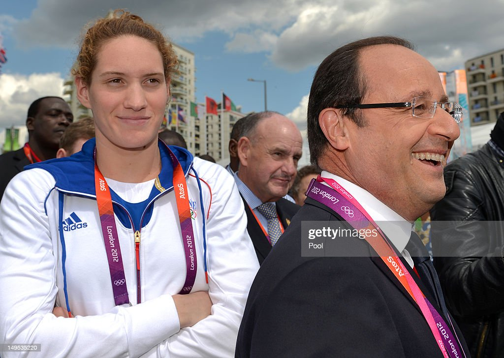 French President Francois Hollande and Camille Muffat who won an Olympic gold medal in the 400m freestyle during a trip to the Olympic village on Day...