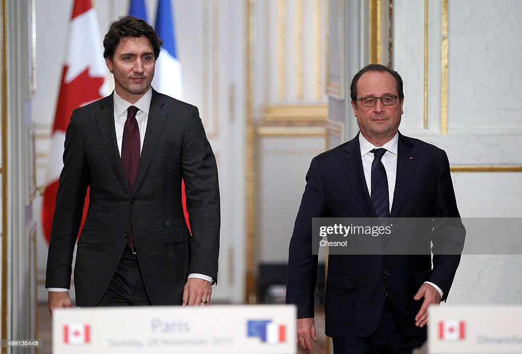 French President Francois Hollande and Canadian Prime minister, Justin Trudeau arrive to attend a press conference at the Elysee Presidential Palace on November 29, 2015 in Paris, France. France will host climate change conference COP21 in Paris from November 30 to December 11, 2015.