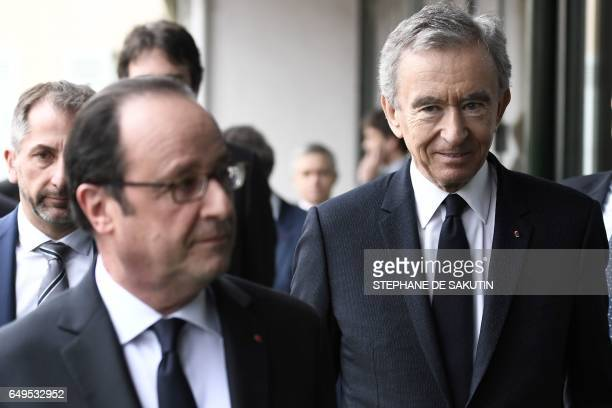 French president Francois Hollande and CEO of LVMH Bernard Arnault arrive to attend a press conference to unveil a new museum in Paris on March 8...