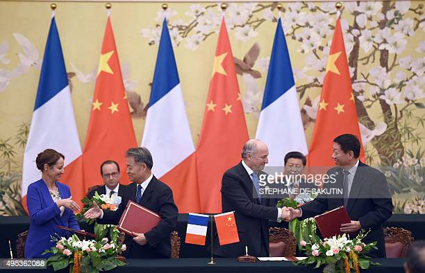 French President Francois Hollande and China's President Xi Jinping attend an agreement session between French environment Minister Segolene Royal...
