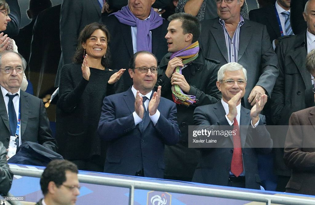 French president Francois Hollande and Claude Bartolone attend the International Friendly Soccer match between France and Portugal at Stade de France on october 11, 2014 in Paris, France.