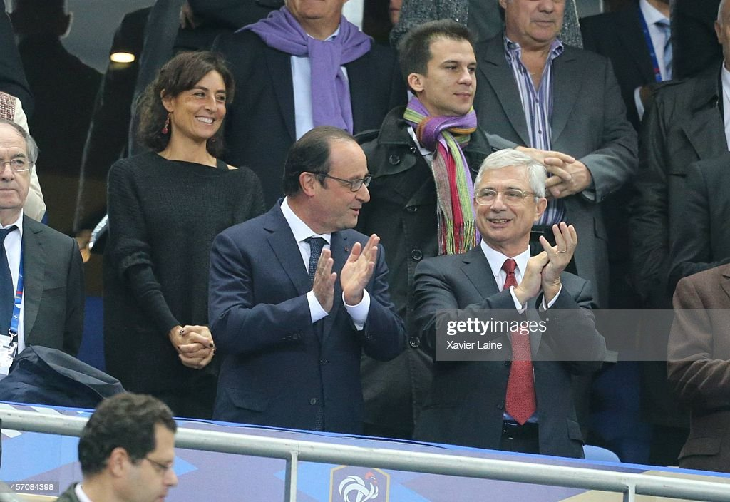 French president Francois Hollande and <a gi-track='captionPersonalityLinkClicked' href=/galleries/search?phrase=Claude+Bartolone&family=editorial&specificpeople=551950 ng-click='$event.stopPropagation()'>Claude Bartolone</a> attend the International Friendly Soccer match between France and Portugal at Stade de France on october 11, 2014 in Paris, France.