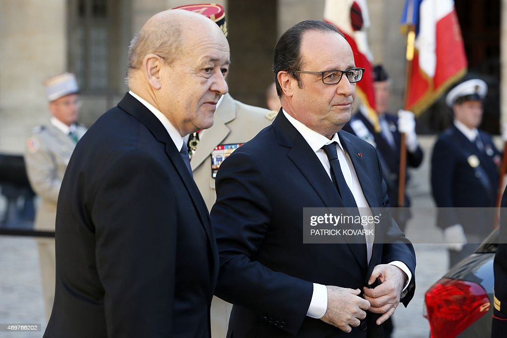 French president Francois Hollande (R) and Defence minister <a gi-track='captionPersonalityLinkClicked' href=/galleries/search?phrase=Jean-Yves+Le+Drian&family=editorial&specificpeople=2122785 ng-click='$event.stopPropagation()'>Jean-Yves Le Drian</a> arrive to attend a state funeral ceremony for late French World War II hero Jean-Louis Cremieux-Brilhac, during his , on April 15, 2015 at the Hotel des Invalides in Paris. A towering figure in the French Resistance, Cremieux-Brilhac, one of the first to condemn the Nazi gas chambers, died on April 8, 2015 aged 98. AFP PHOTO / PATRICK KOVARIK