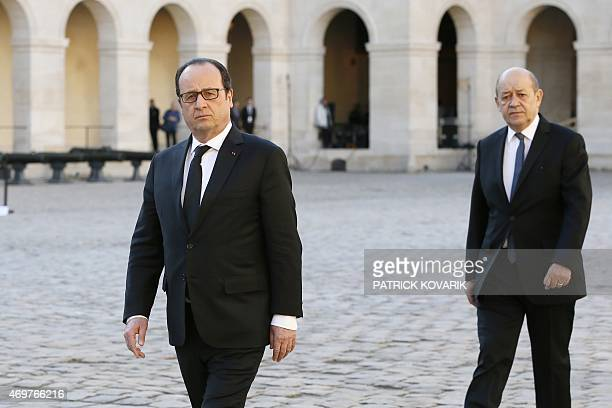 French president Francois Hollande and Defence minister JeanYves Le Drian arrive to attend a state funeral ceremony for late French World War II hero...