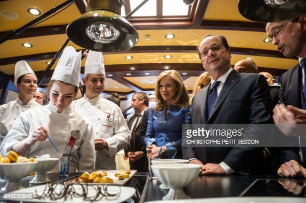 French President Francois Hollande and Disneyland Paris president Catherine Powell visit apprentices as they cook ahead of a ceremony marking the...