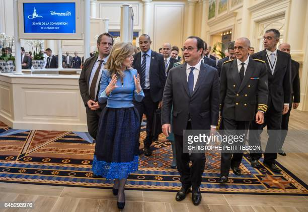 French President Francois Hollande and Disneyland Paris president Catherine Powell walk at the Newport Bay Disney Hotel ahead of a ceremony marking...