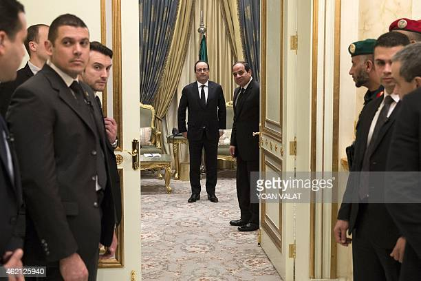 French President Francois Hollande and Egyptian President Abdel Fattah alSisi arrive for a meeting on January 24 2015 in Riyadh as dignitaries and...