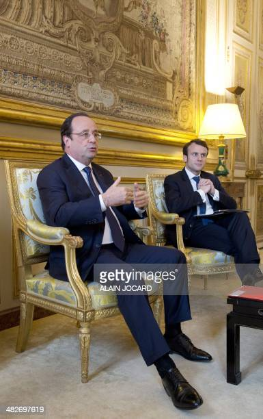 French President Francois Hollande and Elysee's palace deputy secretarygeneral Emmanuel Macron meet with Paris Europlace Chairman and Paris Europlace...