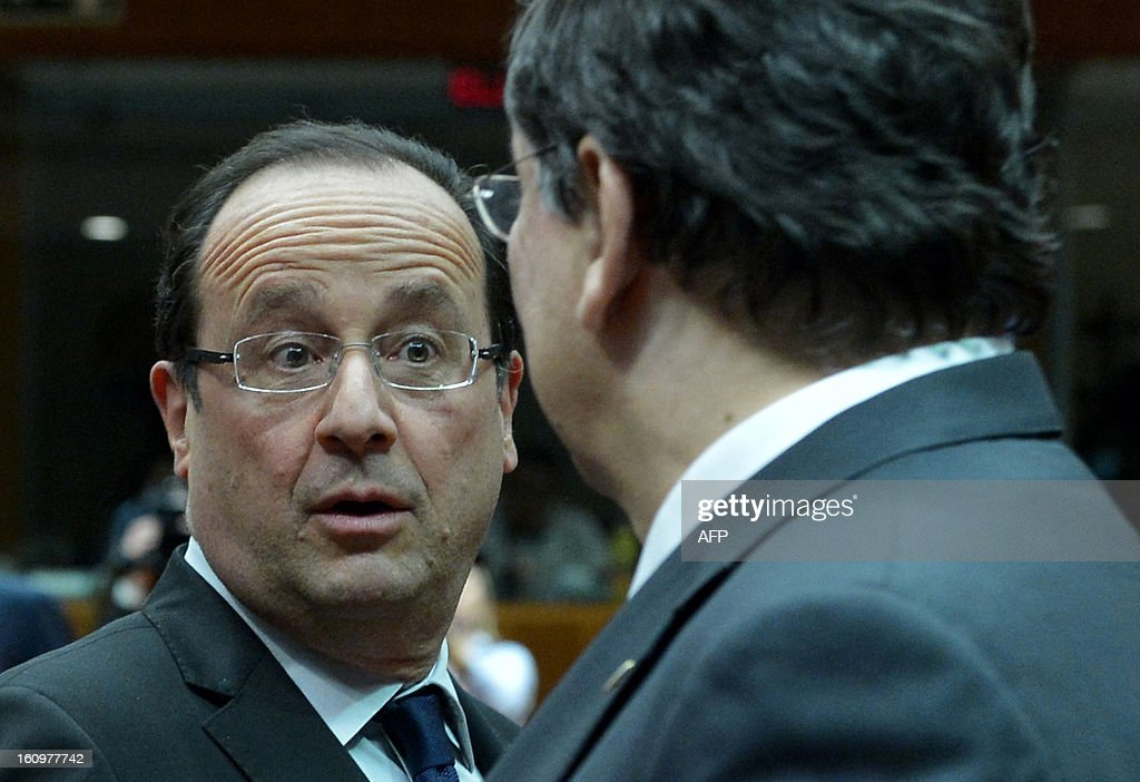 French President Francois Hollande and European Commission President Jose Manuel Barroso chat during a roundtable meeting at the EU Headquarters on February 7, 2013 in Brussels, on the first day of a two-day European Union leaders summit. European Union leaders head into a fresh clash over the EU's budget with the only certainty being that proposals for several years will be cut back.