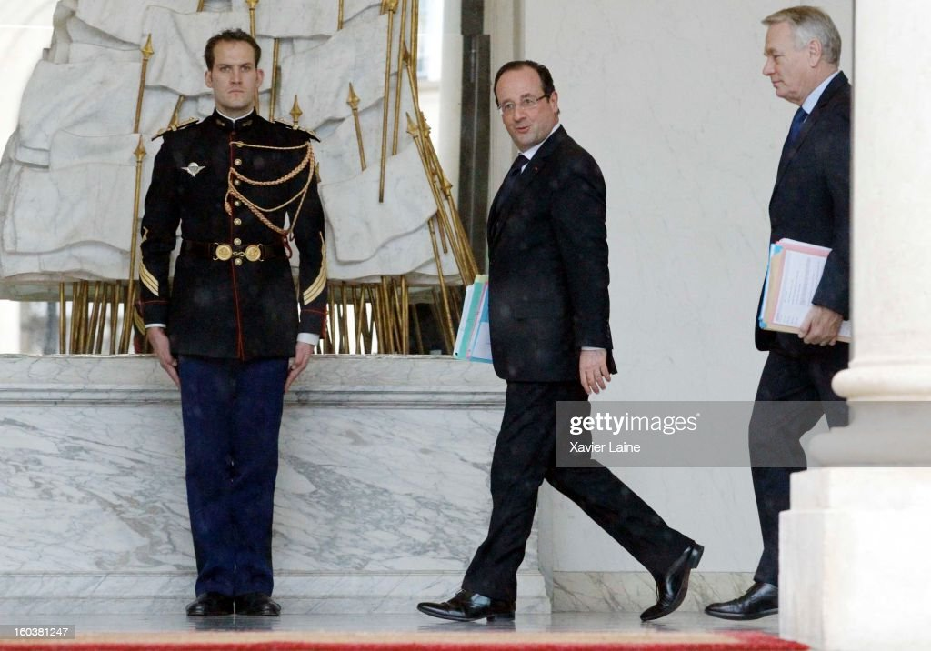 French President Francois Hollande and First Minister <a gi-track='captionPersonalityLinkClicked' href=/galleries/search?phrase=Jean-Marc+Ayrault&family=editorial&specificpeople=551961 ng-click='$event.stopPropagation()'>Jean-Marc Ayrault</a> during the French Cabinet Meeting at Elysee Palace on January 30, 2013 in Paris, France.
