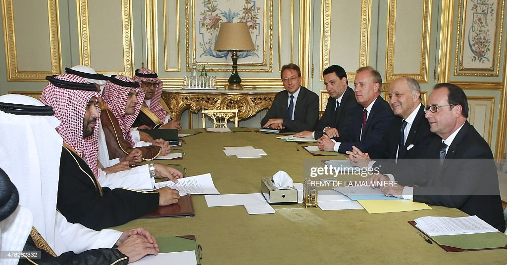 French President Francois Hollande (R) and Foreign Minister Laurent Fabius (2nd-R) meet with Saudi Defence Minister Prince Mohammed bin Salman bin Abdul Aziz al-Saud (2nd-L) at the Elysee Palace in Paris on June 24, 2015. AFP PHOTO / POOL / REMY DE LA MAUVINIERE