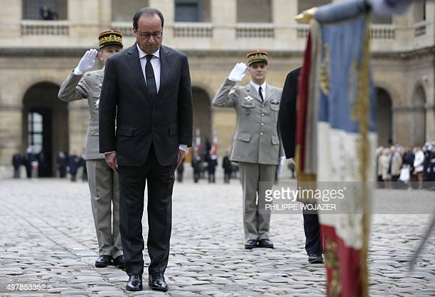French President Francois Hollande and French Army Chief of Staff General Pierre de Villiers attend a military ceremony in the courtyard of the Hotel...