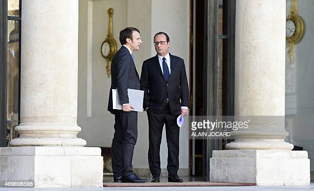French President Francois Hollande and French Economy and Industry minister Emmanuel Macron talk after a meeting with Telecom equipment maker...