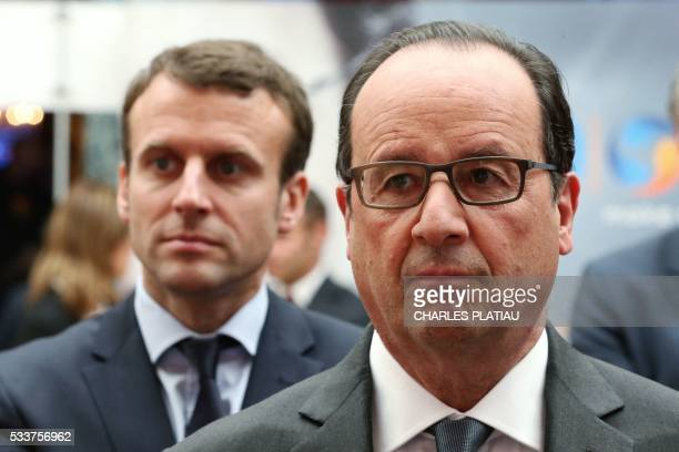 French President Francois Hollande and French Economy Minister Emmanuel Macron attend the Nouvelle France Industrielle event at the Elysee Palace in...