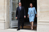 French President Francois Hollande and French Environment Minister Segolene Royal arrive to visit an exhibition during a ceremony marking the first...