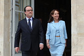 French President Francois Hollande and French Environment Minister Segolene Royal visit an exhibition during a ceremony marking the first anniversary...