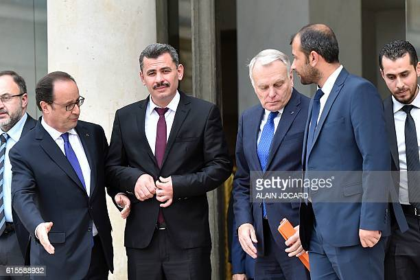 French President Francois Hollande and French Foreign Affairs minister JeanMarc Ayrault escort leader of Syria's White Helmets Raed Saleh and Hagi...