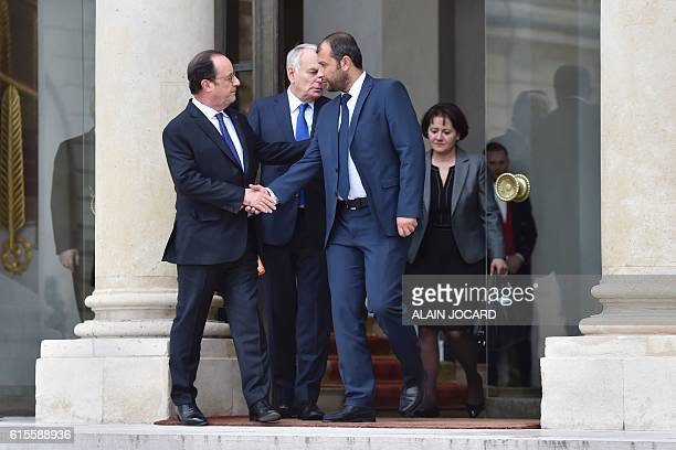 French President Francois Hollande and French Foreign Affairs minister JeanMarc Ayrault escort leader of Syria's White Helmets Raed Saleh as he...