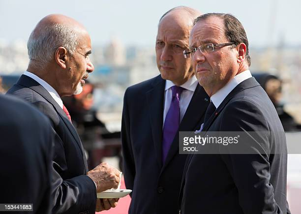 French President Francois Hollande and French Foreign Affairs Minister Laurent Fabius speak with with Mohamed Yousef ElMagariaf President of the...