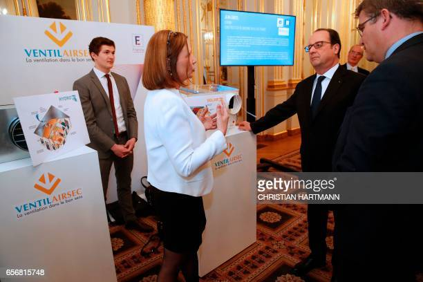French President Francois Hollande and French Junior Minister Christophe Sirugue attend an event on state reform and simplification at the Elysee...
