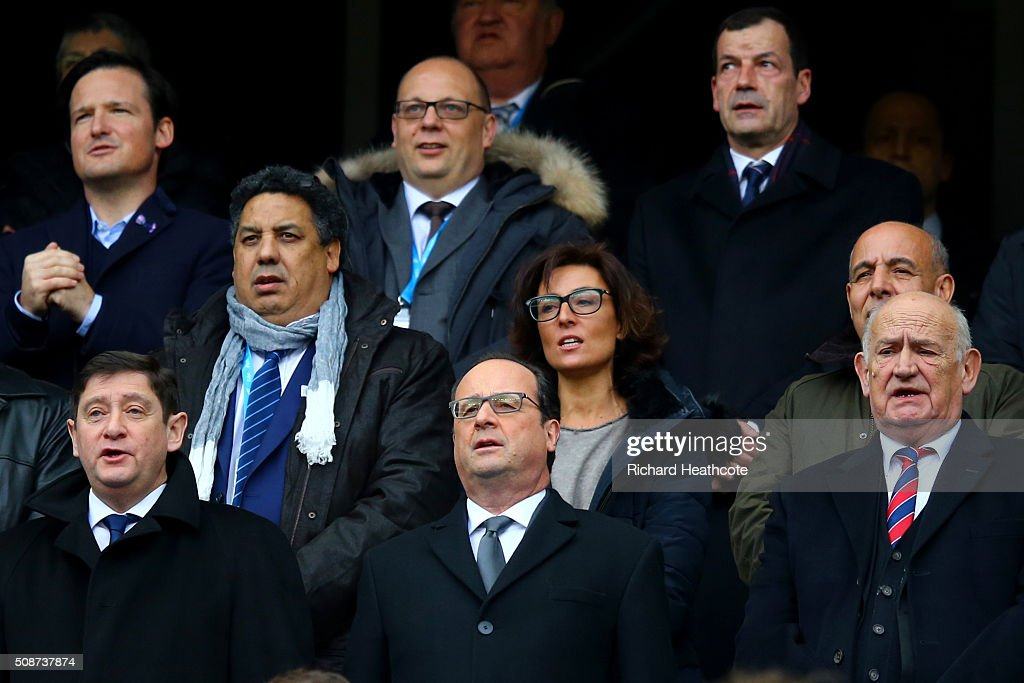 French President Francois Hollande (C) and French Minister for Cities, Youth and Sport, Patrick Kanner sing the national anthem before the RBS Six Nations match between France and Italy at Stade de France on February 6, 2016 in Paris, France.