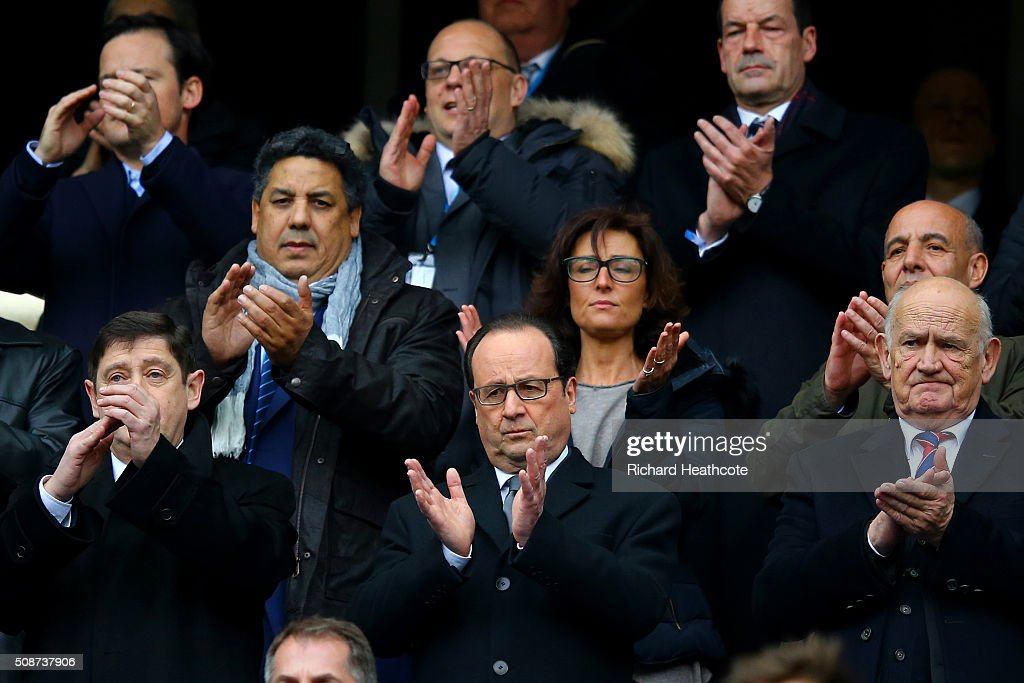 French President Francois Hollande (C) and French Minister for Cities, Youth and Sport, <a gi-track='captionPersonalityLinkClicked' href=/galleries/search?phrase=Patrick+Kanner&family=editorial&specificpeople=7612419 ng-click='$event.stopPropagation()'>Patrick Kanner</a> applaud before the RBS Six Nations match between France and Italy at Stade de France on February 6, 2016 in Paris, France.