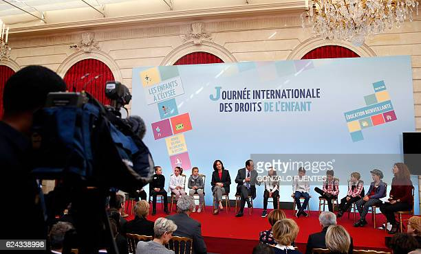 French President Francois Hollande and French Minister for the Family Children and Women's Rights Laurence Rossignol attend a ceremony to mark the...