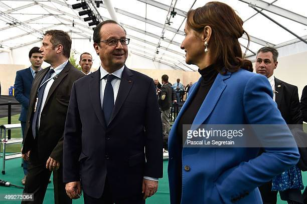 French President Francois Hollande and French Minister of Ecology Sustainable Development and Energy Segolene Royal speak as they attend the Family...