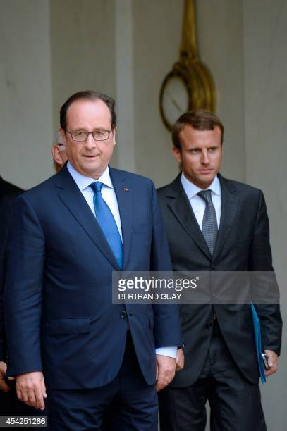 French President Francois Hollande and French newlyappointed Economy Minister Emmanuel Macron are pictured after the weekly cabinet meeting on August...