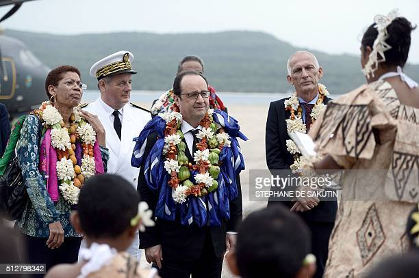 French President Francois Hollande and French Overseas Territories Minister George PauLangevin attend a ceremony in Futuna island on February 22 in...