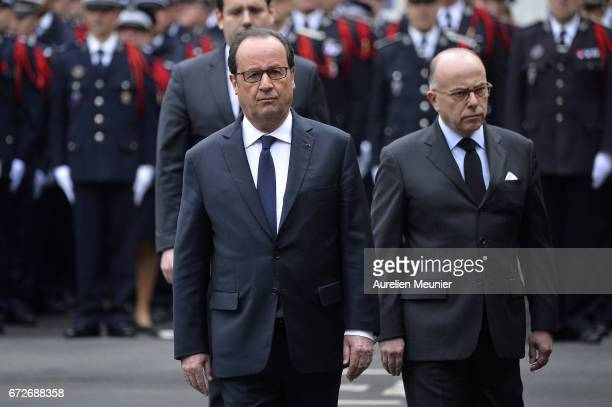 French President Francois Hollande and French Prime Minister Bernard Cazeneuve attend the National tribute to fallen French Policeman Xavier Jugele...