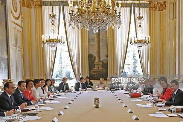 French President Francois Hollande and French Prime Minister Manuel Valls pose with ministers of the cabinet prior to a government seminar at the...