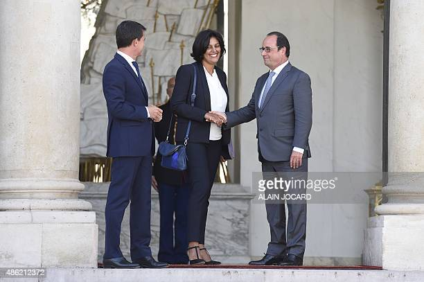 French president Francois Hollande and French Prime Minister Manuel Valls escort the new French Labour minister Myriam El Khomri after her...