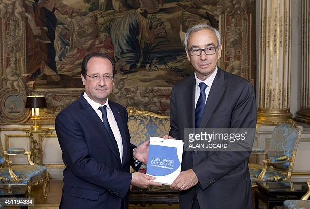 French president Francois Hollande and General comissioner of the general strategy and prospective Jean PisaniFerry pose with the report 'La France...