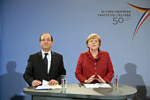 French President Francois Hollande and German Chancellor Angela Merkel address a press conference at the chancellery in Berlin on January 21 as part...