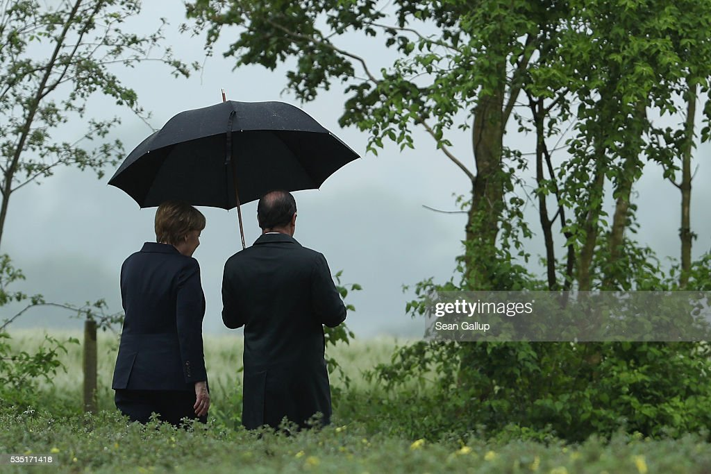 French President Francois Hollande and German Chancellor Angela Merkel depart after laying a wreath at the German World War I military cemetery at Consonvoye during ceremonies to commemorate the 100th anniversary of the World War I Battle of Verdun on May 29, 2016 near Verdun, France. The 1916, 10-month battle pitted the French and German armies against one another in a grueling campaign of trench warfare and artillery bombardments that killed a total of approximately 300,000 soldiers. The events today coincide with the 50th anniversary of commemorations held at Verdun by then French President Charles de Gaulle and German Chancellor Konrad Adenauer that paved the way for a new era of peaceful, post-war Franco-German relations.