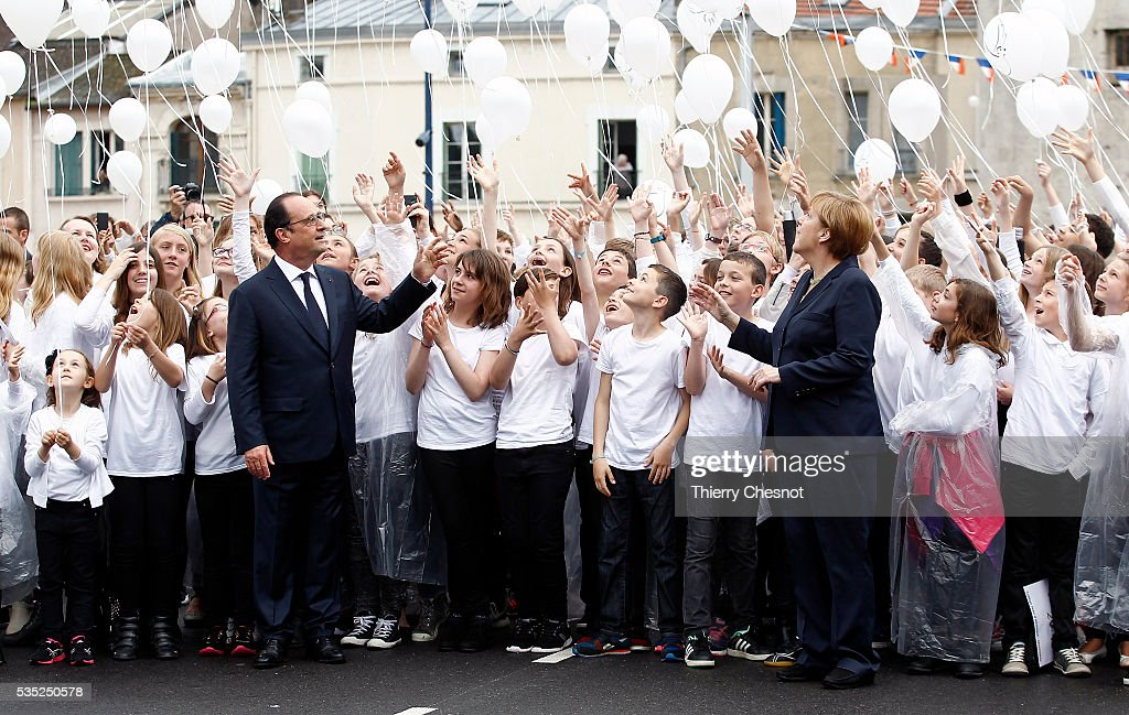 French President Francois Hollande and German Chancellor <a gi-track='captionPersonalityLinkClicked' href=/galleries/search?phrase=Angela+Merkel&family=editorial&specificpeople=202161 ng-click='$event.stopPropagation()'>Angela Merkel</a> attend a balloons drop with children during ceremonies to commemorate the 100th anniversary of the World War I Battle of Verdun on May 29, 2016 near Verdun, France. The 1916, 10-month battle pitted the French and German armies against one another in a gruelling campaign of trench warfare and artillery bombardments that killed a total of approximately 300,000 soldiers. The events today coincide with the 50th anniversary of commemorations held at Verdun by then French President Charles de Gaulle and German Chancellor Konrad Adenauer that paved the way for a new era of peaceful, post-war Franco-German relations.