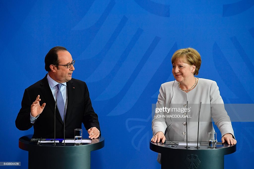 French President Francois Hollande and German Chancellor Angela Merkel address a press conference with Italy's Prime Minister ahead of talks following the Brexit referendum at the chancellery in Berlin, on June 27, 2016. Britain's shock decision to leave the EU forces German Chancellor Angela Merkel into the spotlight to save the bloc, but true to her reputation for prudence, she said she would act neither hastily nor nastily. / AFP / John MACDOUGALL